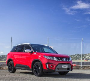 Suzuki Vitara Sport parked in front of wire fence