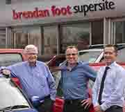 Brendan, Matthew and David Foot in front of Brendan Foot Supersite building