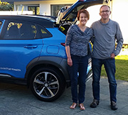 Kick for a Kona winners Claire and Russell Underwood standing by the Hyundai Kona